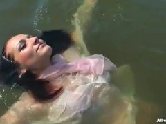 Chick in a sexy blouse takes a dip in the lake movies at freekilomovies.com