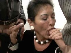 Mature in her work clothes strokes two dicks videos