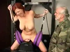 Busty redhead in bondage vibrated videos