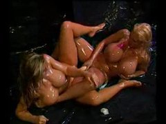 Huge boobs oiled up girls share a big dildo movies at sgirls.net