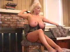 Curvy blonde in corset has a good time teasing videos