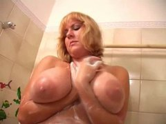 Blonde babe gropes her big natural tits in shower videos