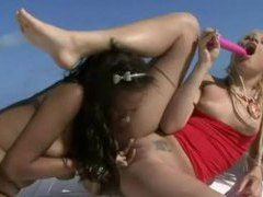 Girls on a boat have sex with toys videos