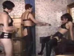 Two dominatrix babes with a latex girl videos