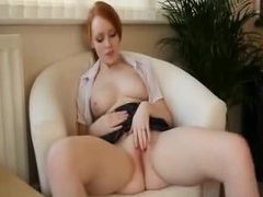 Young redhead in business outfit strips and teases movies at kilopics.net