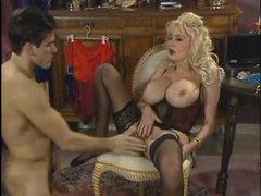 Retro porn scene with blonde in black lingerie tubes