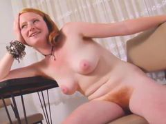 Redhead with furry bush and pits poses solo movies at kilosex.com