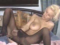 She masturbates while in black pantyhose videos