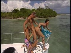 Boat trip leads to threesome on the beach videos