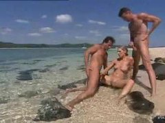 Two guys cum on a slut on the beach videos