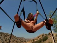 Girls in the sex swing masturbate until squirting tubes