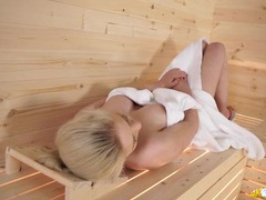 Blonde wrapped in a towel flashes in the sauna movies at kilosex.com