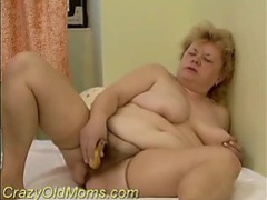 Chubby mom using a banana videos