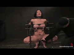 Girl in painful bondage and nipple clamps has her pussy vibed tubes