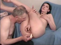 Two dildos penetrate the milf movies at freekilopics.com