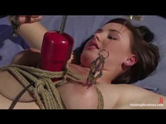 She's tied up and being taken by a dildo machine videos