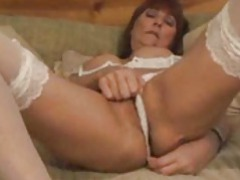 The hot naked mature babe is in white lingerie movies at kilogirls.com