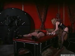 Girl is tied to the table and the mistress is having fun videos