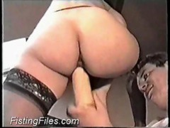 Big dildo loosens her up and then she gets anally fisted movies at lingerie-mania.com