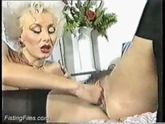 Old babe fisted while she uses a toy in her ass movies at lingerie-mania.com