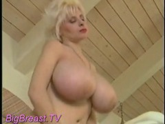 Blonde with enormous tits playing naked movies at lingerie-mania.com
