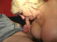 Mature with big knockers gives a bj movies at lingerie-mania.com
