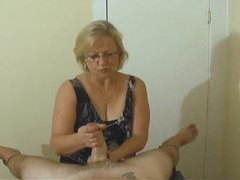Mature with skills gives pov handjob movies at lingerie-mania.com
