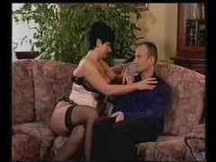 Gal in corset feeds him her tits videos