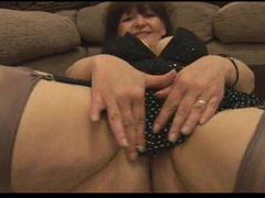 Teasing mature in stockings showing her hairy pussy tubes