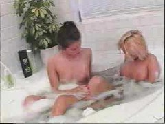 Cute chicks touch each other in the bath movies at lingerie-mania.com