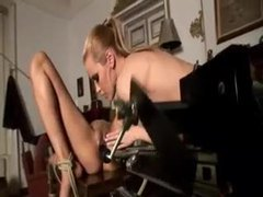 Tied girl on the desk takes a dildo movies at sgirls.net