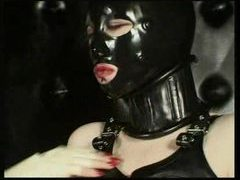 Rubber girls with hot tits play movies at very-sexy.com