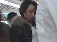 Japanese girl giving hj on crowded train tubes at japanese.sgirls.net