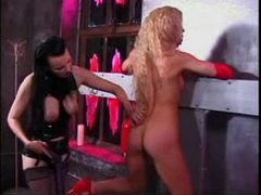 Lesdom in the dungeon with latex and spanking tubes