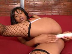 Sexy black chick in fishnets toys her anus movies