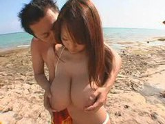 Asian bikini babe roaming the beach videos