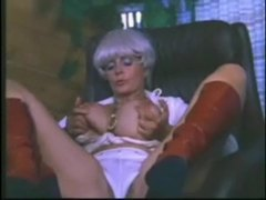 Retro porn milf likes to show her big tits videos