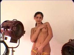 Skinny girl in yellow panties takes a toy videos
