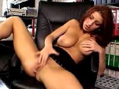 Busty redhead in home office masturbates tubes