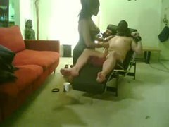 Black mistress binds and strokes her slave tubes