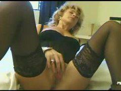 Milf wears arousing lingreie and rubs her clit videos