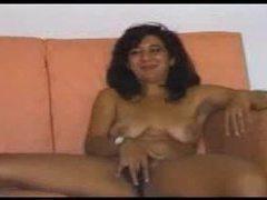 Mature gal gets naked and masturbates videos