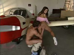Airplane hangar scene with girl on big cock clip