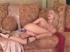 She strips from lace and toys her pussy videos