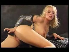 Busty babe in shiny silver slowly toy fucks pussy movies at kilomatures.com