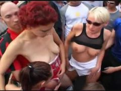 Chicks dance naked in a big crowd outdoors videos