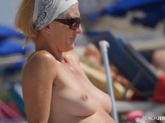 Milf and her perky tits look hot in the sand movies at adipics.com