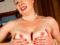 Classy milf teases us by stripping erotically videos