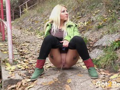 Blonde on a walk takes a piss in public videos