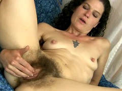 Milf is hairy all over as she rubs her clitoris tubes